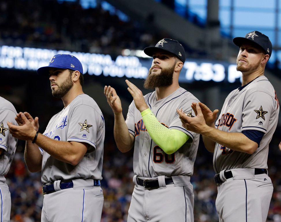 . American League\'s Kansas City Mike Moustakas (8), Houston Astros pitchers Dallas Keuchel (60) and Chris Devenski (47), applaud during introductions at the MLB baseball All-Star Game, Tuesday, July 11, 2017, in Miami. (AP Photo/Lynne Sladky)