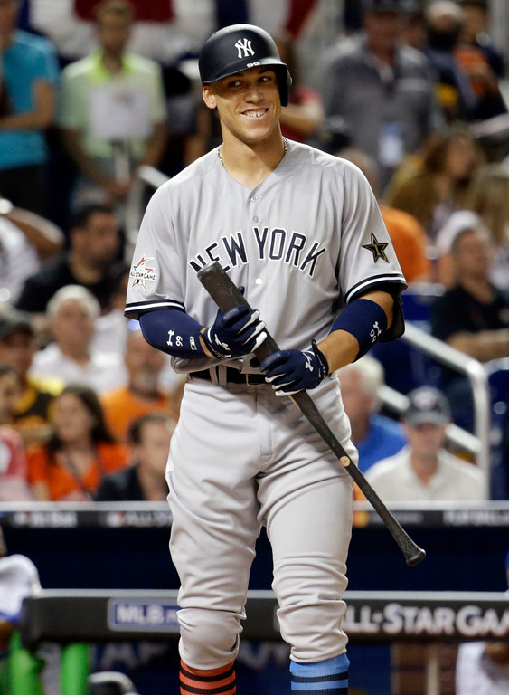 . American League\'s New York Yankees Aaron Judge (99), smiles in between pitches in the fifth inning, during the MLB baseball All-Star Game, Tuesday, July 11, 2017, in Miami. (AP Photo/Lynne Sladky)