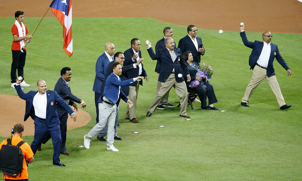 . Baseball Hall of Fame players throw the ceremonial first pitch before the MLB baseball All-Star Game, Tuesday, July 11, 2017, in Miami. (AP Photo/Wilfredo Lee)