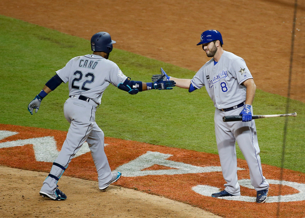 . American League\'s Seattle Mariners Robinson Cano (22), is congratulated by Kansas City Mike Moustakas, after Cano hit a home run in the tenth inning, during the MLB baseball All-Star Game, Tuesday, July 11, 2017, in Miami. (AP Photo/Wilfredo Lee)