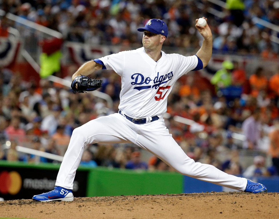 . National League\'s Los Angeles Dodgers pitcher Alex Wood (57), delivers a pitch during the fifth inning, at the MLB baseball All-Star Game, Tuesday, July 11, 2017, in Miami. (AP Photo/Lynne Sladky)