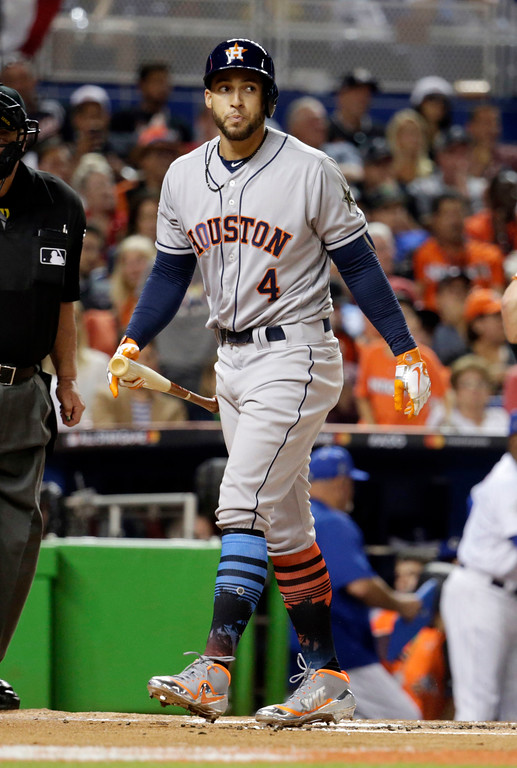 . American League\'s Houston Astros George Springer (4) walks back to the dugout after striking out, during the first inning at the MLB baseball All-Star Game, Tuesday, July 11, 2017, in Miami. (AP Photo/Lynne Sladky)