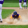 Monty Tech's Brian Glover dives back to first base during the game against Blackstone Valley on Tuesday afternoon. SENTINEL & ENTERPRISE / Ashley Green