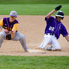 Monty Tech's Troy Leslie checks Blackstone Valley 's Tommy Morin back to the bag during the game on Tuesday afternoon. SENTINEL & ENTERPRISE / Ashley Green