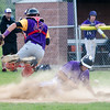 Blackstone Valley 's Tommy Morin slides in safely under the tag of Monty Tech catcher Rory Cockerline during the game on Tuesday afternoon. SENTINEL & ENTERPRISE / Ashley Green
