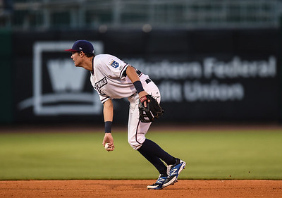 Northwest Arkansas Naturals second baseman Logan Davis (26) throws to second during NWA Naturals vs Tulsa Drillers ballgame at Arvest Ballpark in Springdale, Arkansas, on Thursday, June 25, 2015.  The Drillers won 3-2.  Photos by Alan Jamison.