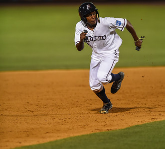 Northwest Arkansas Naturals left fielder Terrance Gore (3) heads for third during NWA Naturals vs Tulsa Drillers ballgame at Arvest Ballpark in Springdale, Arkansas, on Thursday, June 25, 2015.  The Drillers won 3-2.  Photos by Alan Jamison.