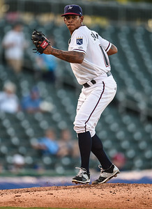Northwest Arkansas Naturals pitcher J.C. Sulbaran (15) throws to first during NWA Naturals vs Tulsa Drillers ballgame at Arvest Ballpark in Springdale, Arkansas, on Thursday, June 25, 2015.  The Drillers won 3-2.  Photos by Alan Jamison.