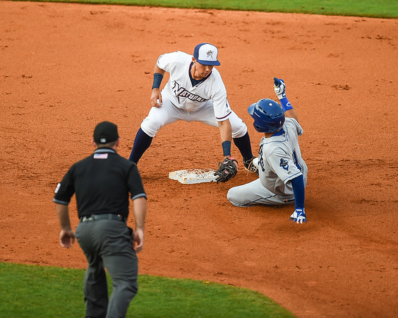 Northwest Arkansas Naturals shortstop Kenny Diekroeger (8) tags Tulsa Drillers shortstop Ronald Torreyes (4) at second in a ballgame between the NWA Naturals and the Tulsa Drillers at Arvest Ballpark in Springdale, Arkansas, on Friday, June 26, 2015.  The Drillers won 5-1.  Photos by Alan Jamison.