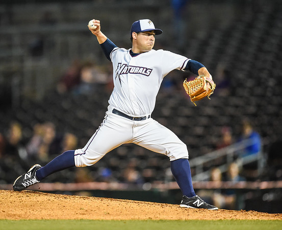 Northwest Arkansas Naturals relief pitcher Benino Pruneda (14) pitches in a ballgame between the NWA Naturals and the Tulsa Drillers at Arvest Ballpark in Springdale, Arkansas, on Friday, June 26, 2015.  The Drillers won 5-1.  Photos by Alan Jamison.