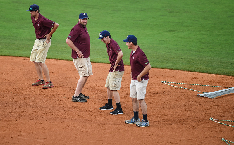 The NWA grounds crew provides entertainment in a ballgame between the NWA Naturals and the Tulsa Drillers at Arvest Ballpark in Springdale, Arkansas, on Friday, June 26, 2015.  The Drillers won 5-1.  Photos by Alan Jamison.