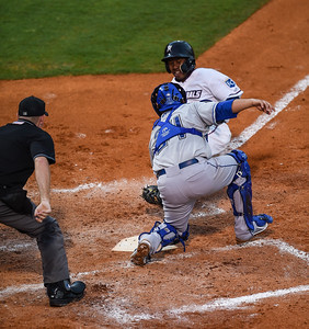 Northwest Arkansas Naturals designated hitter Terrance Gore (3) gets tagged at home plate by Tulsa Drillers catcher Ali Solis (24) in a ballgame between the NWA Naturals and the Tulsa Drillers at Arvest Ballpark in Springdale, Arkansas, on Friday, June 26, 2015.  The Drillers won 5-1.  Photos by Alan Jamison.