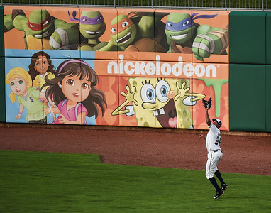 Northwest Arkansas Naturals right fielder Jorge Bonifacio (24) catches a fly ball in a ballgame between the NWA Naturals and the Tulsa Drillers at Arvest Ballpark in Springdale, Arkansas, on Friday, June 26, 2015.  The Drillers won 5-1.  Photos by Alan Jamison.
