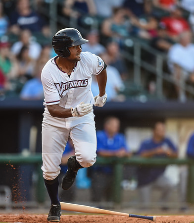 Northwest Arkansas Naturals designated hitter Jorge Bonifacio (24) runs to first in a ballgame between the NWA Naturals and the Tulsa Drillers at Arvest Ballpark in Springdale, Arkansas, on Saturday, June 27, 2015.  The Naturals won 2-1 in extra innings.  Photos by Alan Jamison.