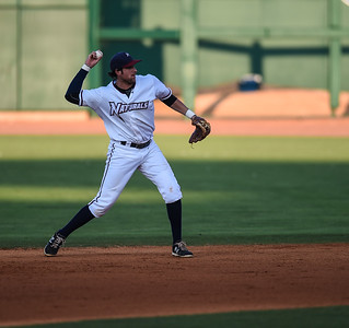 Northwest Arkansas Naturals second baseman Alex Liddi (22) throws to first in a ballgame between the NWA Naturals and the Tulsa Drillers at Arvest Ballpark in Springdale, Arkansas, on Saturday, June 27, 2015.  The Naturals won 2-1 in extra innings.  Photos by Alan Jamison.