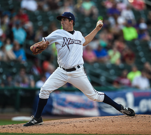 Northwest Arkansas Naturals starting pitcher Jonathan Dziedzic (12) pitches in a ballgame between the NWA Naturals and the Tulsa Drillers at Arvest Ballpark in Springdale, Arkansas, on Saturday, June 27, 2015.  The Naturals won 2-1 in extra innings.  Photos by Alan Jamison.