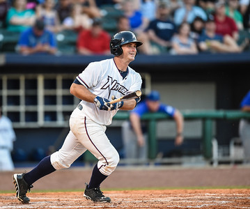 Northwest Arkansas Naturals catcher Micah Gibbs (7) bats in a ballgame between the NWA Naturals and the Tulsa Drillers at Arvest Ballpark in Springdale, Arkansas, on Saturday, June 27, 2015.  The Naturals won 2-1 in extra innings.  Photos by Alan Jamison.