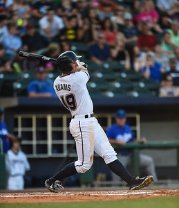 Northwest Arkansas Naturals right fielder Lane Adams (19) bats in a ballgame between the NWA Naturals and the Tulsa Drillers at Arvest Ballpark in Springdale, Arkansas, on Saturday, June 27, 2015.  The Naturals won 2-1 in extra innings.  Photos by Alan Jamison.