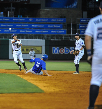 Northwest Arkansas Naturals shortstop Kenny Diekroeger (8) throws to first to turn a double play in a ballgame between the NWA Naturals and the Tulsa Drillers at Arvest Ballpark in Springdale, Arkansas, on Saturday, June 27, 2015.  The Naturals won 2-1 in extra innings.  Photos by Alan Jamison.