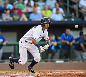 Northwest Arkansas Naturals shortstop Kenny Diekroeger (8) bunts in a ballgame between the NWA Naturals and the Tulsa Drillers at Arvest Ballpark in Springdale, Arkansas, on Saturday, June 27, 2015.  The Naturals won 2-1 in extra innings.  Photos by Alan Jamison.