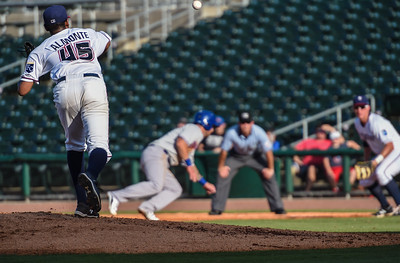 Northwest Arkansas Naturals pitcher Miguel Almonte (45) throws to first in a baseball game between the NWA Naturals and the Midland RockHounds at Arvest Ballpark in Springdale, Arkansas, on Sunday, July 12, 2015.  The RockHounds won 2-0.  Photos by Alan Jamison.