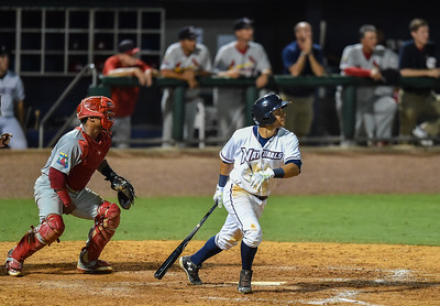 Naturals second baseman Ramon Torres (27) hits during a baseball game between the NWA Naturals and the Springfield Cardinals at Arvest Ballpark in Springdale, Arkansas, on Thursday, July 30, 2015.  The Cardinals won 6-3.  Photos by Alan Jamison.