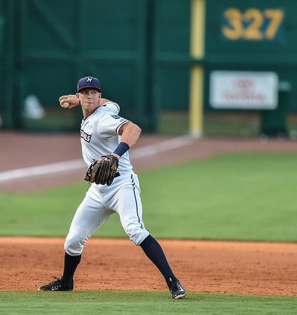 Naturals third baseman Hunter Dozier (9) throws to first during a baseball game between the NWA Naturals and the Springfield Cardinals at Arvest Ballpark in Springdale, Arkansas, on Thursday, July 30, 2015.  The Cardinals won 6-3.  Photos by Alan Jamison.