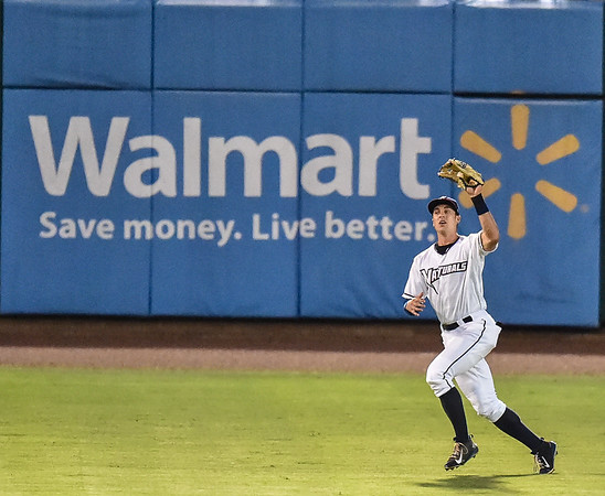 Naturals left fielder Lane Adams (19) catches a fly ball during a baseball game between the NWA Naturals and the Springfield Cardinals at Arvest Ballpark in Springdale, Arkansas, on Thursday, July 30, 2015.  The Cardinals won 6-3.  Photos by Alan Jamison.