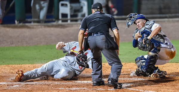 Naturals catcher Parker Morin (21) tags out Cardinals third baseman Patrick Wisdom (5) during a baseball game between the NWA Naturals and the Springfield Cardinals at Arvest Ballpark in Springdale, Arkansas, on Thursday, July 30, 2015.  The Cardinals won 6-3.  Photos by Alan Jamison.