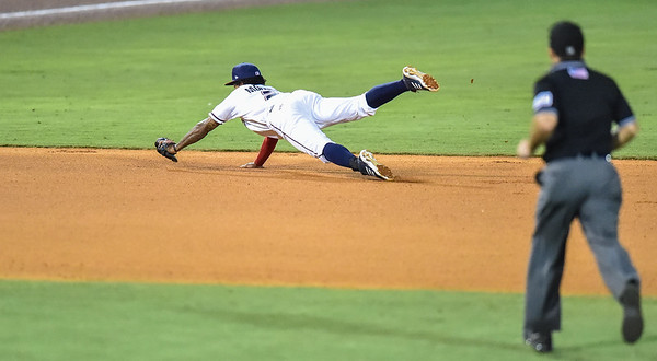 Naturals shortstop Raul Mondesi (2) divees to catch a ball during a baseball game between the NWA Naturals and the Springfield Cardinals at Arvest Ballpark in Springdale, Arkansas, on Thursday, July 30, 2015.  The Cardinals won 6-3.  Photos by Alan Jamison.