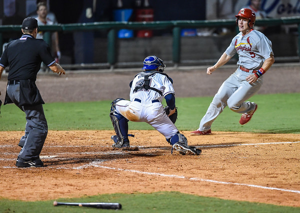 Naturals catcher Parker Morin (21) prepares to tag out Cardinals third baseman Patrick Wisdom (5) during a baseball game between the NWA Naturals and the Springfield Cardinals at Arvest Ballpark in Springdale, Arkansas, on Thursday, July 30, 2015.  The Cardinals won 6-3.  Photos by Alan Jamison.