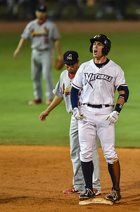 Naturals left fielder Lane Adams (19) celebrates a double during a baseball game between the NWA Naturals and the Springfield Cardinals at Arvest Ballpark in Springdale, Arkansas, on Thursday, July 30, 2015.  The Cardinals won 6-3.  Photos by Alan Jamison.