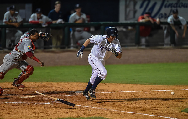 Naturals first baseman Frank Schwindel (23) bunts during a baseball game between the NWA Naturals and the Springfield Cardinals at Arvest Ballpark in Springdale, Arkansas, on Thursday, July 30, 2015.  The Cardinals won 6-3.  Photos by Alan Jamison.
