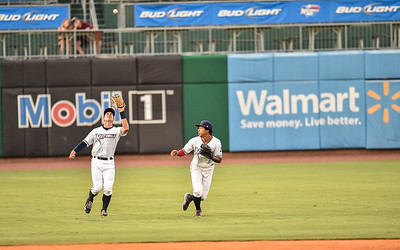 Naturals left fielder Lane Adams (19) catches a fly ball while shortstop Raul Mondesi (2) watches during a baseball game between the NWA Naturals and the Springfield Cardinals at Arvest Ballpark in Springdale, Arkansas, on Thursday, July 30, 2015.  The Cardinals won 6-3.  Photos by Alan Jamison.