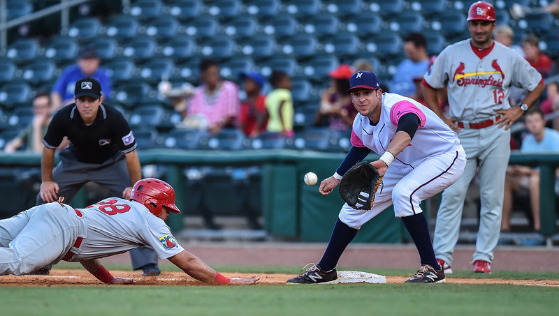 Northwest Arkansas Naturals first baseman Alex Liddi (22) holds Springfield Cardinals first baseman Jonathan Rodriguez (28) on first during a baseball game between the NWA Naturals and the Springfield Cardinals at Arvest Ballpark in Springdale, Arkansas, on Friday, July 31, 2015.  The Cardinals won 11-1 in front of a crowd of 5,889.  Photos by Alan Jamison.