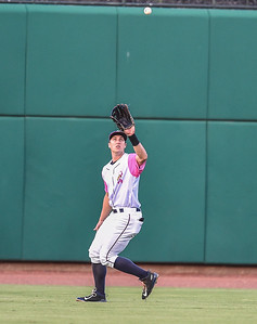 Northwest Arkansas Naturals center fielder Lane Adams (19) catches a fly ball during a baseball game between the NWA Naturals and the Springfield Cardinals at Arvest Ballpark in Springdale, Arkansas, on Friday, July 31, 2015.  The Cardinals won 11-1 in front of a crowd of 5,889.  Photos by Alan Jamison.