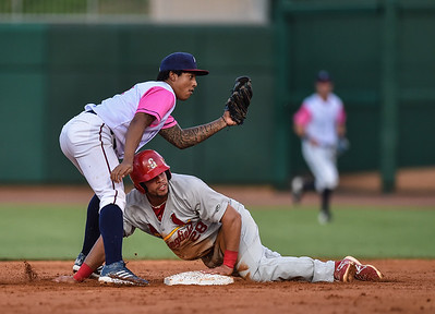 Springfield Cardinals first baseman Jonathan Rodriguez (28) steals second from Northwest Arkansas Naturals second baseman Raul Mondesi (2) during a baseball game between the NWA Naturals and the Springfield Cardinals at Arvest Ballpark in Springdale, Arkansas, on Friday, July 31, 2015.  The Cardinals won 11-1 in front of a crowd of 5,889.  Photos by Alan Jamison.