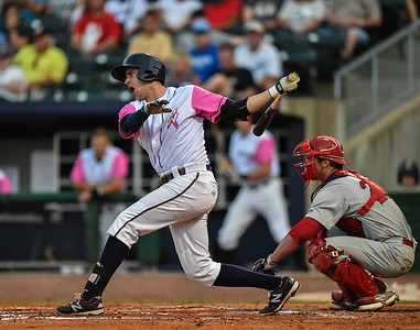 Northwest Arkansas Naturals first baseman Alex Liddi (22) bats during a baseball game between the NWA Naturals and the Springfield Cardinals at Arvest Ballpark in Springdale, Arkansas, on Friday, July 31, 2015.  The Cardinals won 11-1 in front of a crowd of 5,889.  Photos by Alan Jamison.