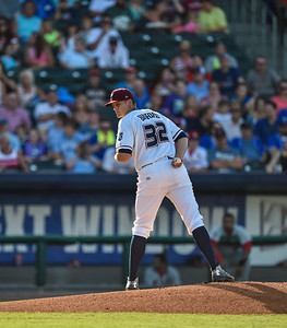 Northwest Arkansas Naturals pitcher Christian Binford (32) looks to first base during a baseball game between the NWA Naturals and the Springfield Cardinals at Arvest Ballpark in Springdale, Arkansas, on Saturday, August 1, 2015.  The Naturals won 6-5 in front of a crowd of 5,005.  Photos by Alan Jamison.