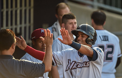 Northwest Arkansas Naturals shortstop Ramon Torres (27) celebrates a run during a baseball game between the NWA Naturals and the Springfield Cardinals at Arvest Ballpark in Springdale, Arkansas, on Saturday, August 1, 2015.  The Naturals won 6-5 in front of a crowd of 5,005.  Photos by Alan Jamison.