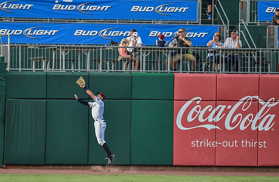 Northwest Arkansas Naturals center fielder Lane Adams (19) leaps to catch a fly ball during a baseball game between the NWA Naturals and the Springfield Cardinals at Arvest Ballpark in Springdale, Arkansas, on Saturday, August 1, 2015.  The Naturals won 6-5 in front of a crowd of 5,005.  Photos by Alan Jamison.
