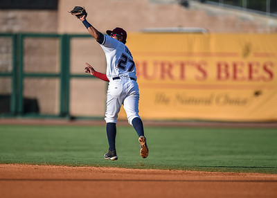 Northwest Arkansas Naturals shortstop Ramon Torres (27) with a nice leaping catch during a baseball game between the NWA Naturals and the Springfield Cardinals at Arvest Ballpark in Springdale, Arkansas, on Saturday, August 1, 2015.  The Naturals won 6-5 in front of a crowd of 5,005.  Photos by Alan Jamison.