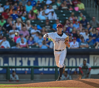 Northwest Arkansas Naturals pitcher Christian Binford (32) throws to first base during a baseball game between the NWA Naturals and the Springfield Cardinals at Arvest Ballpark in Springdale, Arkansas, on Saturday, August 1, 2015.  The Naturals won 6-5 in front of a crowd of 5,005.  Photos by Alan Jamison.