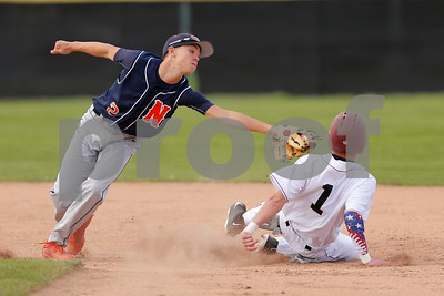 Danville High School outfielder Logan Smith (1) avoids the tag from North Montgomery High School infielder Kai Warren (2) to steal second during the game between North Montgomery vs Danville at  Danville High School in Danville,IN. (Jeff Brown/Flyer Photo)