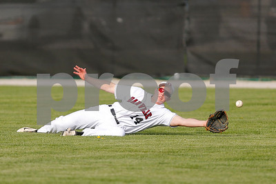 Danville High School right fielder Gavin Hensely (14) makes a diving attempt on the fly ball during the game between North Montgomery vs Danville at  Danville High School in Danville,IN. (Jeff Brown/Flyer Photo)