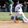 SAM HOUSEHOLDER | THE GOSHEN NEWS<br /> Wawasee senior third baseman Caleb Dingeldein tags out NorthWood junior Alex Teske during the sectional championship game Monday.