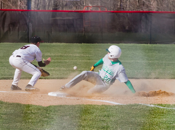 SAM HOUSEHOLDER | THE GOSHEN NEWS<br /> Northridge NUMBER 20 slides safe into third as NorthWood third baseman Hunter Lane catches the ball Wednesday during the game.