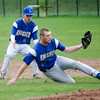 Lunenburg third baseman Austin Stewart dives in front of shortstop Drew Thibeault to make a catch during the game against Oakmont on Friday afternoon. SENTINEL & ENTERPRISE / Ashley Green