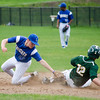 Oakmont's Paul Barrett is tagged out by Lunenburg's Chris Vacarelo during the game on Friday afternoon. SENTINEL & ENTERPRISE / Ashley Green