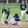 Lunenburg's Drew Thibeault slides safely under the tag of Oakmont's Zach Batten during the game on Friday afternoon. SENTINEL & ENTERPRISE / Ashley Green